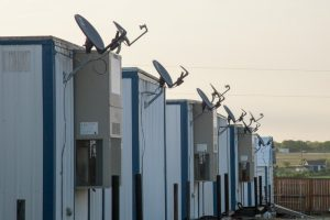 Modular building units with satellite dishes
